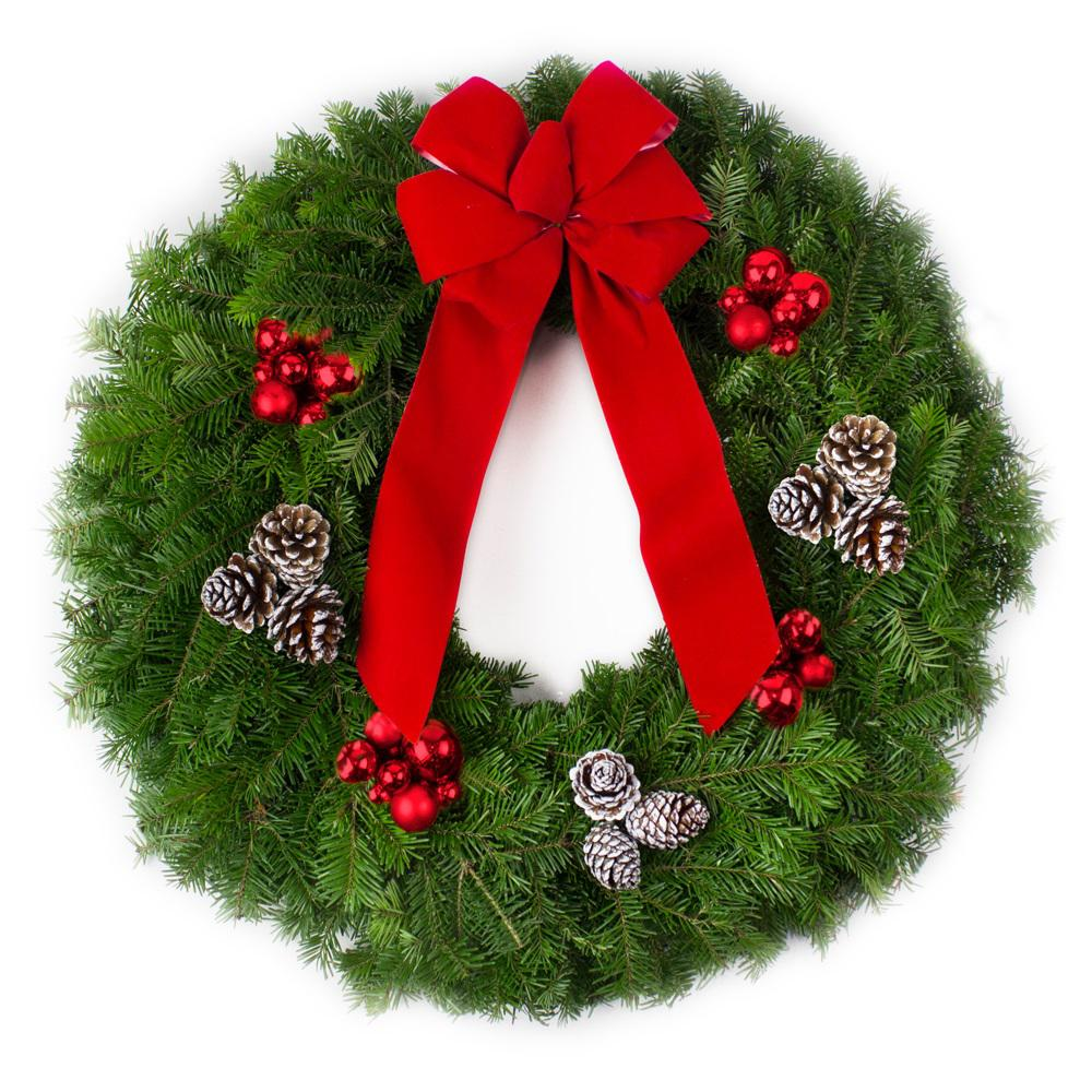 live balsam fir christmas wreath with red bow red ornaments and frosted pinecones