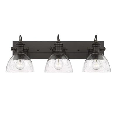 Hines 3-Light Bath Vanity in Rubbed Bronze with Seeded Glass