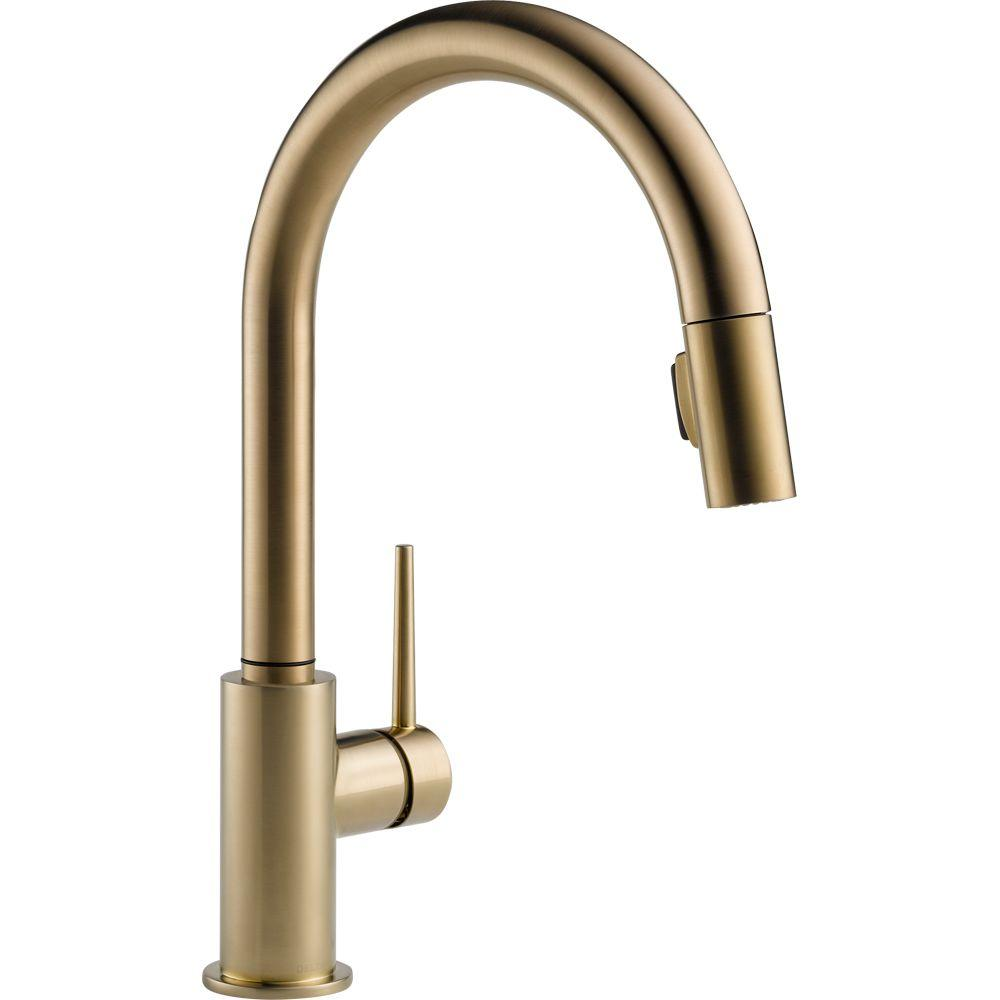 Trinsic Single Handle Pull Down Sprayer Kitchen Faucet In Champagne Bronze Featuring Magnae Docking