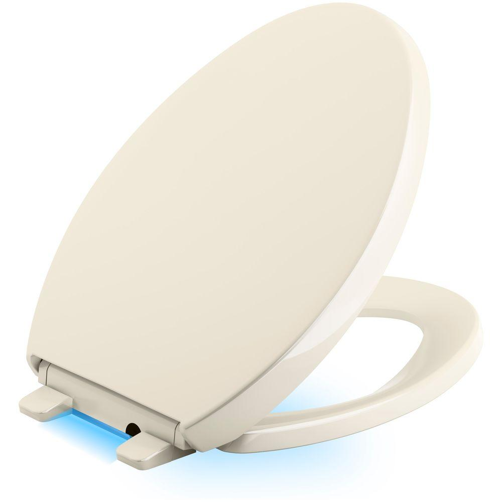 Reveal LED Nightlight Elongated Closed Front Toilet Seat in Almond