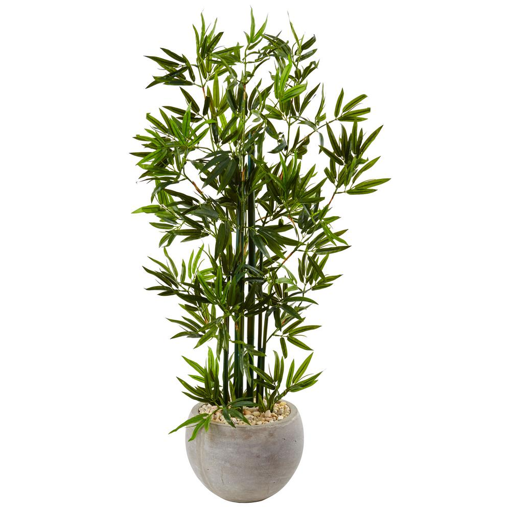 Nearly natural indoor bamboo artificial tree in sand