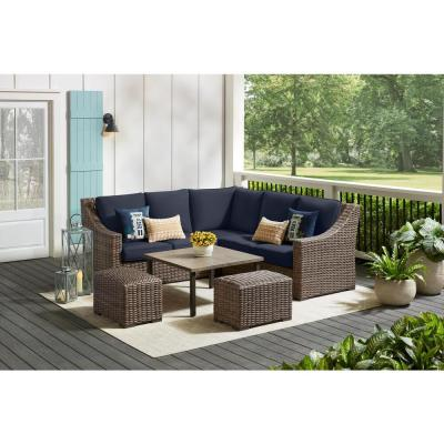Rock Cliff 6-Piece Brown Wicker Outdoor Patio Sectional Sofa Set with Ottoman and CushionGuard Midnight Navy Cushions