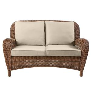 Beacon Park Brown Wicker Outdoor Patio Loveseat with CushionGuard Putty Tan Cushions