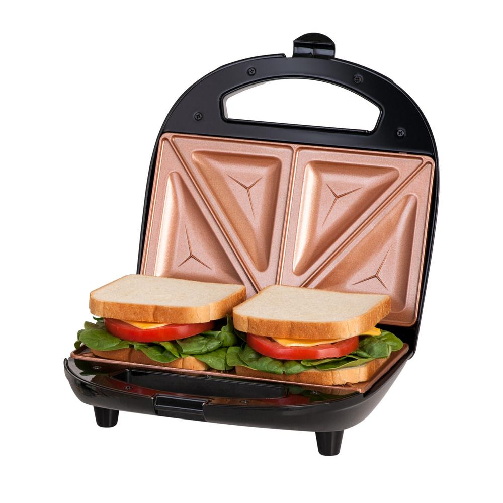 Non-Stick Ti-Ceramic Black Finish Sandwich Press, Black/Nonstick Ti-Ceramic Coating Enjoy a hot, delicious, homemade sandwiches in under 5 minutes with this sandwich grill by Gotham Steel. This compact grill features the non-stick Ti-Ceramic grill plates to ensure easy food release and clean up. A sleek exterior to prevent burns and scalds. Evenly grills two items at a time; open the lid and your hot homemade sandwiches are ready to eat. Color: Black/ Nonstick Ti-Ceramic Coating.