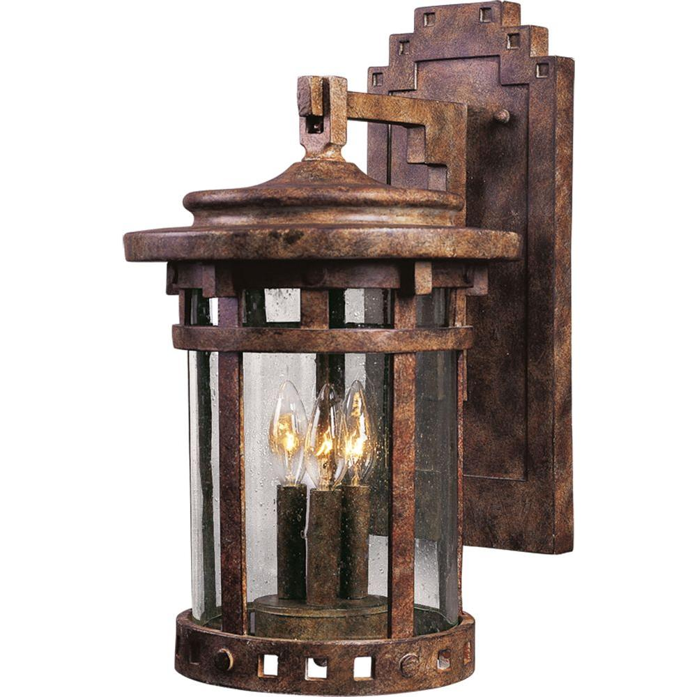 Maxim Lighting Santa Barbara DC-Outdoor Wall Lantern Sconce Santa Barbara Cast is a transitional style collection from Maxim Lighting International in Sienna finish with Seedy glass.
