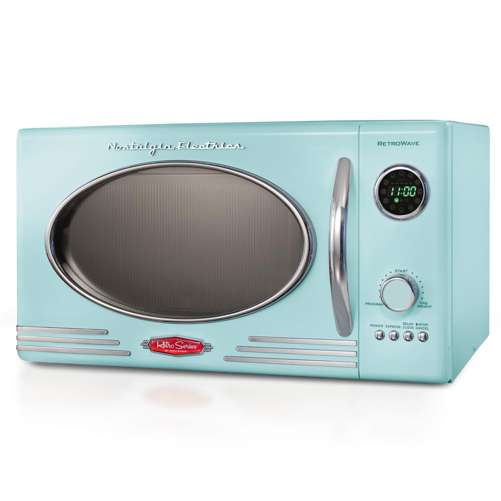 Nostalgia 0.9 cu. ft. Countertop Microwave Oven in Aqua, Blue/Purple With a beautiful and sleek retro design, this microwave is sure to stand out in any kitchen. It features 12-pre programmed cooking settings and a bright LED display, making usability simple. Five power levels and 800-watts of power are perfect for reheating leftovers or cooking food. Color: Blue/Purple.