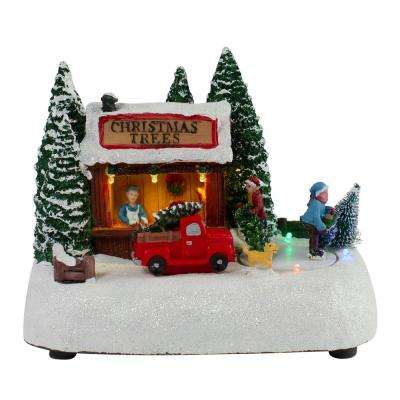 6.25 in. H x 8 in. W LED Lighted and Musical Christmas Village Tree Shop Table Top Decoration