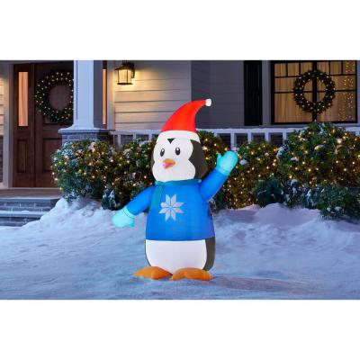 3.5 ft Pre-Lit LED Inflatable Outdoor Penguin in Sweater