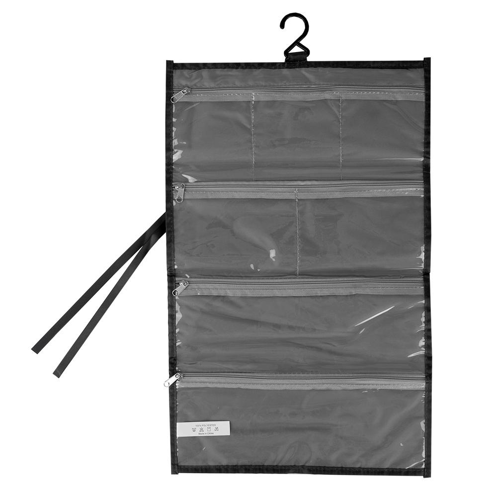 Home Basics Nylon Travel Hanging Organizer, Black Keep all your jewelry and accessories all in one place wherever you go with this hanging accessory organizer. Made of nylon. It features a plastic cover and zipper closure for easy visibility and organization. Features Four long and wide compartments to accommodate a wide range of items. Color: Black.