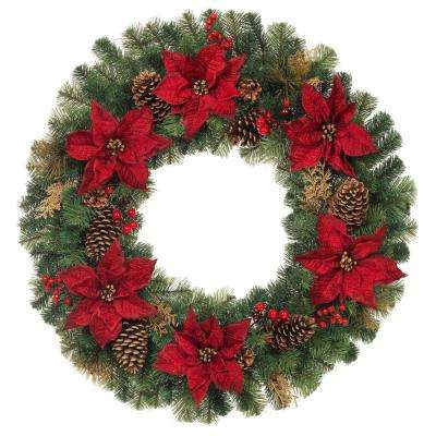 unlit artificial christmas pine wreath with burgundy poinsettias
