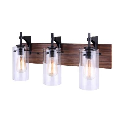 Arlie 24 in. 3-Light Matte Black and Wood Vanity Light with Clear Glass Shade