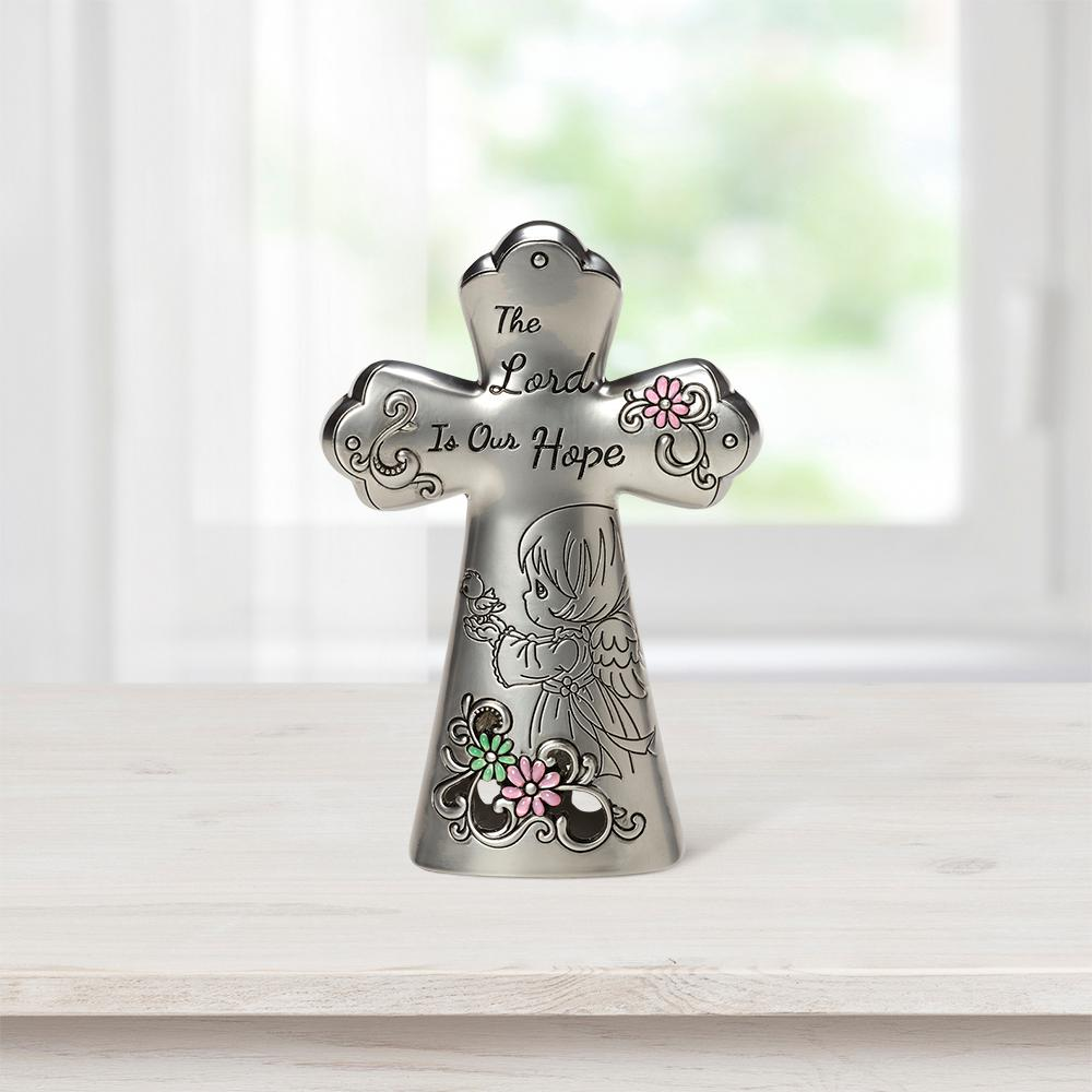 Precious Moments Tabletop Cross Zinc Alloy The Lord Is Our Hope Mini Figurine, Multi Eye-catching silvery cross with subtle splashes of color shares an uplifting sentiment and is graced with a hopeful angel. An inspirational accent for any home or office, it adds a touch of faith wherever a reminder is needed that  the Lord is our hope . Give this Precious Moments cross as a thoughtful religious gift for religious occasions, or as a housewarming, 'thinking of you' or 'just because' gift. Crafted of hollow cast zinc alloy. Approximately 3.5 in. H. Color: Multi.
