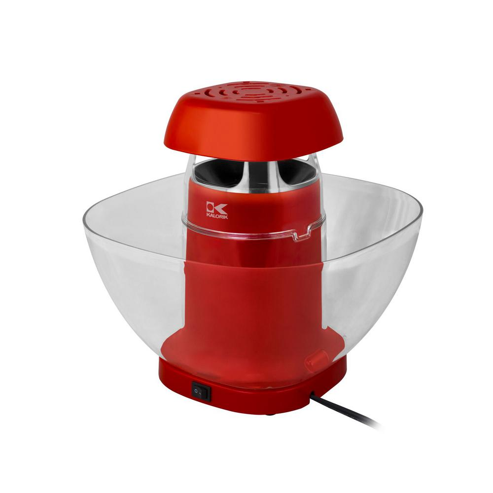 KALORIK Red Volcano Popcorn Maker, Red/Orange Prepare popcorn and have it ready to serve at the same time. The Kalorik Red Volcano Popcorn Makers unique design allows kernels to pop and fall directly into the oversized serving bowl, remove the bowl with ease for serving. It is an eruption of popcorn sure to impress all your guests. A measuring spoon and butter dish are included and the removable lid makes for easy cleaning. With no oil required, a healthy snack is ready to serve in no time. Color: Red/Orange.