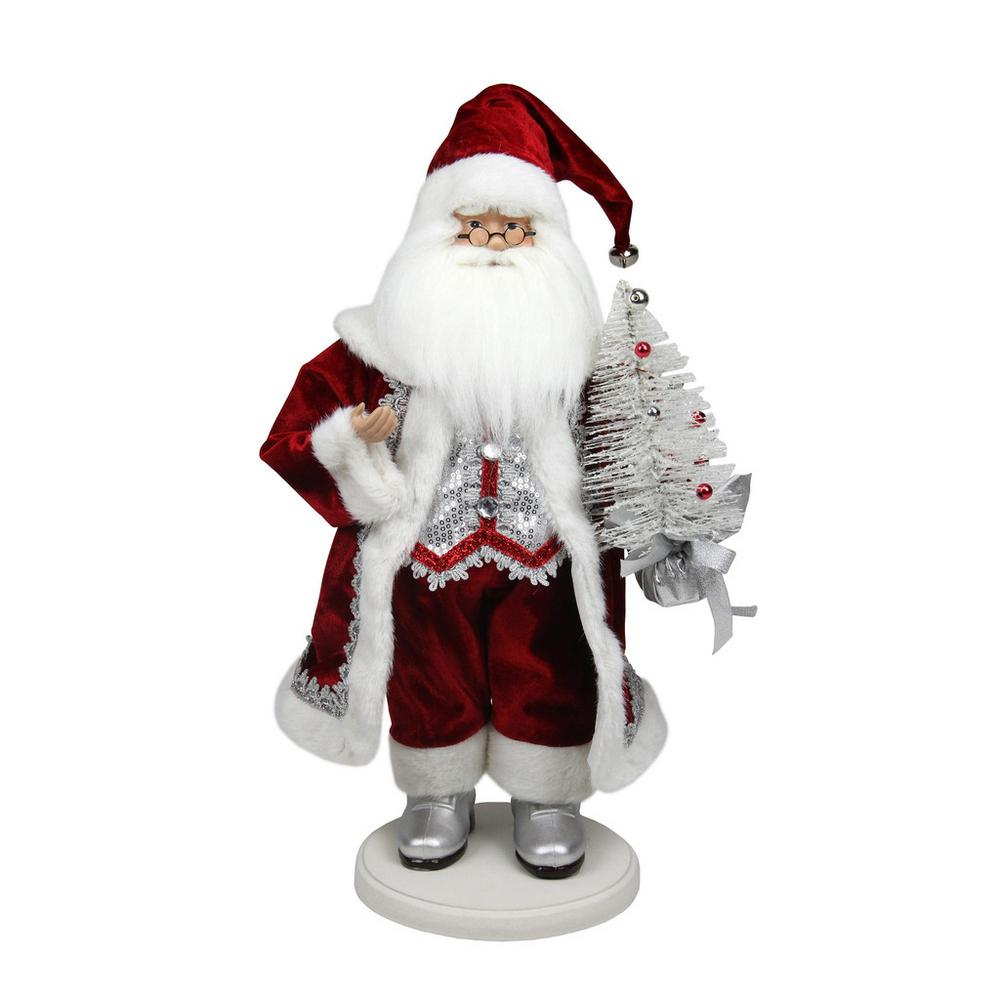 red white and silver santa claus with christmas tree tabletop decoration