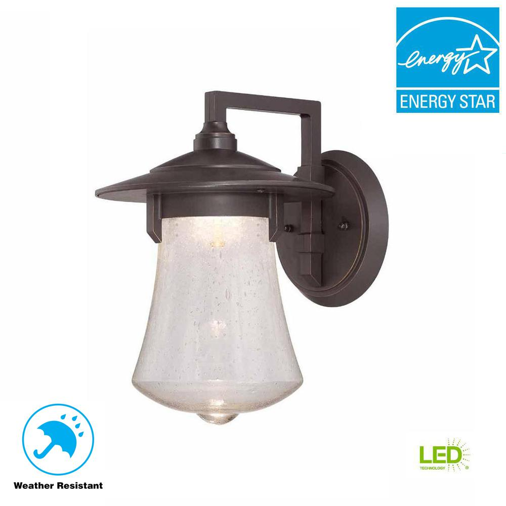 World Imports 8 in. Aged Bronze Patina Outdoor LED Wall Sconce with Clear Seedy Glass