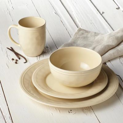 Cucina Dinnerware 16-Piece Stoneware Dinnerware Set in Almond Cream