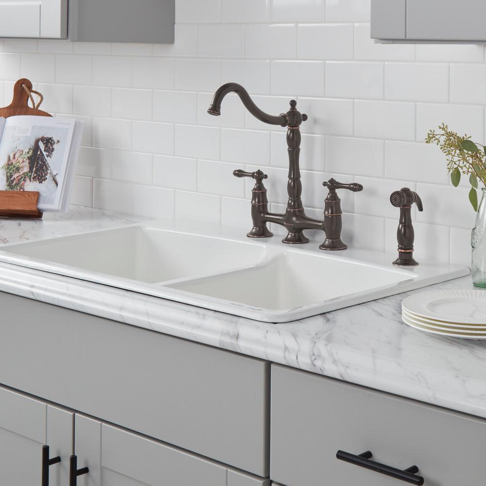 Lyndhurst 2-Handle Bridge Kitchen Faucet with Side Sprayer in Bronze
