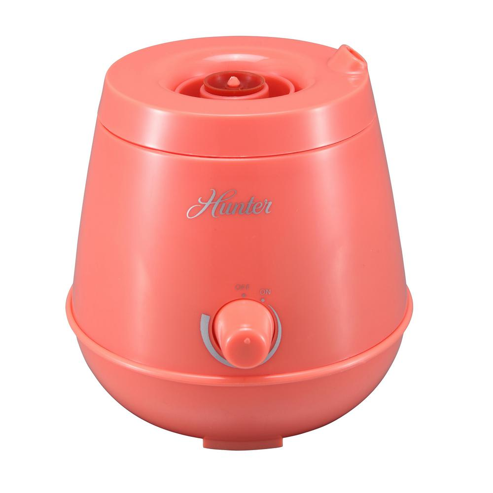 Hunter Personal Ultrasonic Humidifier in Coral Pink, Reds/Pinks Hunter's Personal Ultrasonic Humidifier is designed to be ultra-portable, allowing you to maintain comfortable and healthy humidity wherever you may need it. Ingeniously designed to use most plastic water bottles as a tank, it is a perfect travel companion as only the base is necessary to bring along in your carry-on. Ultrasonic technology is among the quietest of all humidifiers and the QLS-03 comes in a variety of colors to suit your style and taste to be a welcome addition to any personal space. Color: Reds / Pinks.