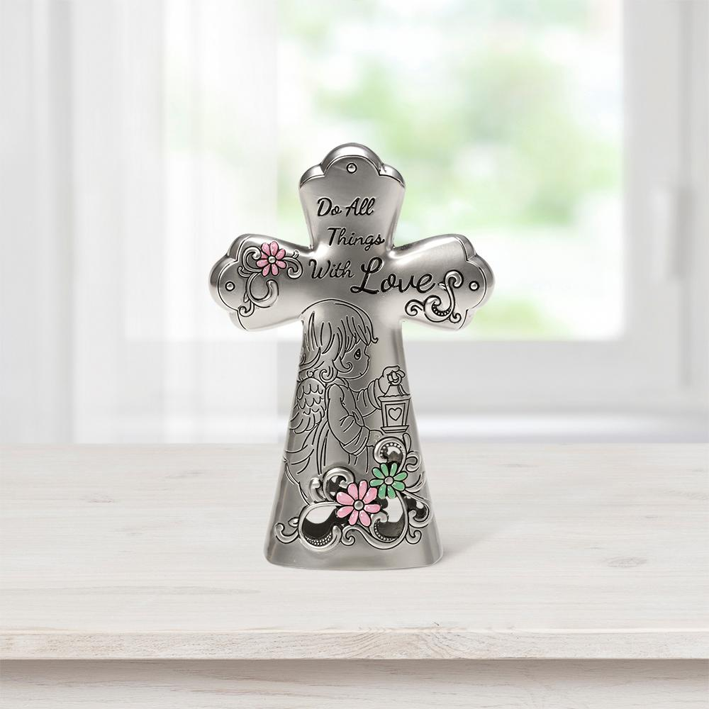 Precious Moments Tabletop Cross Zinc Alloy Do All Things With Love Mini Figurine, Multi Eye-catching silvery cross with subtle splashes of color shares an uplifting sentiment and is graced with a loving angel. An inspirational accent for any home or office, it adds a touch of faith wherever a reminder is needed to  Do all things with love . Give this Precious Moments cross as a thoughtful religious gift for religious occasions as a housewarming or 'just because' gift. Crafted of hollow cast zinc alloy. Approximately 3.5 in. H. Color: Multi.
