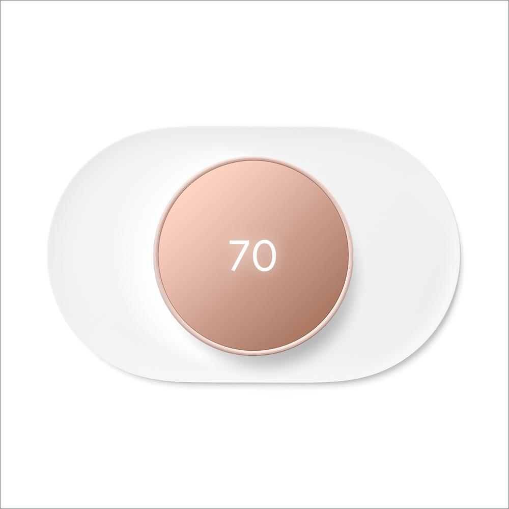 """Google Nest Thermostat Sand + Nest Thermostat Trim Kit Snow, Brown Pair a Google Nest Thermostat with the Nest Thermostat Trim Kit for a perfect match. The Nest Thermostat is the helpful thermostat with a cozy price. It can turn itself down to save energy when you leave the house. You can control it from anywhere with the Google Home app – whether you're on an errand or on vacation. You can even change the temperature without getting off the couch or out of bed. Just say, """"Hey Google, turn up the heat.""""1 The Nest Thermostat Trim Kit is designed to cover imperfections on the wall from removing your old thermostat. Color: Sand."""