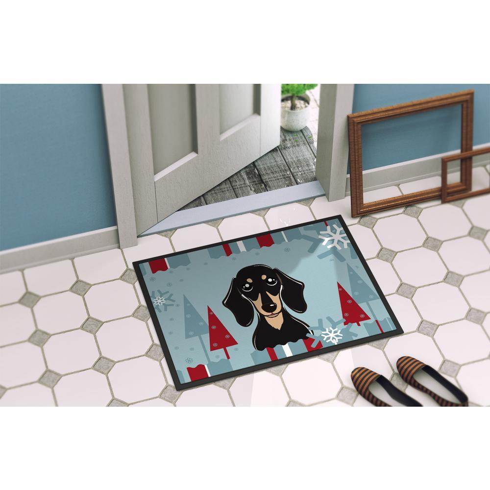 Carolines Treasures Merry Christmas Carolers Black Labrador Kitchen or Bath Mat Multicolor 24 x 36