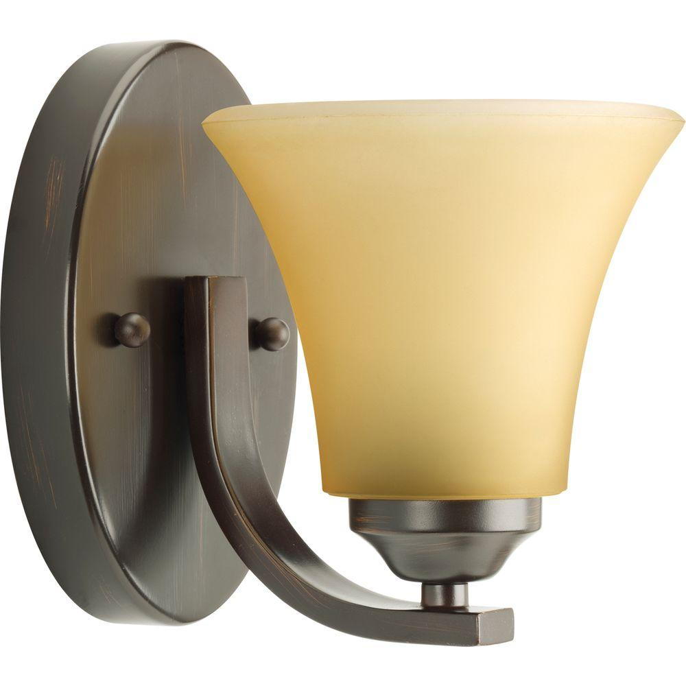 Adorn Collection 1-Light Antique Bronze Bath Sconce with Etched Light Umber