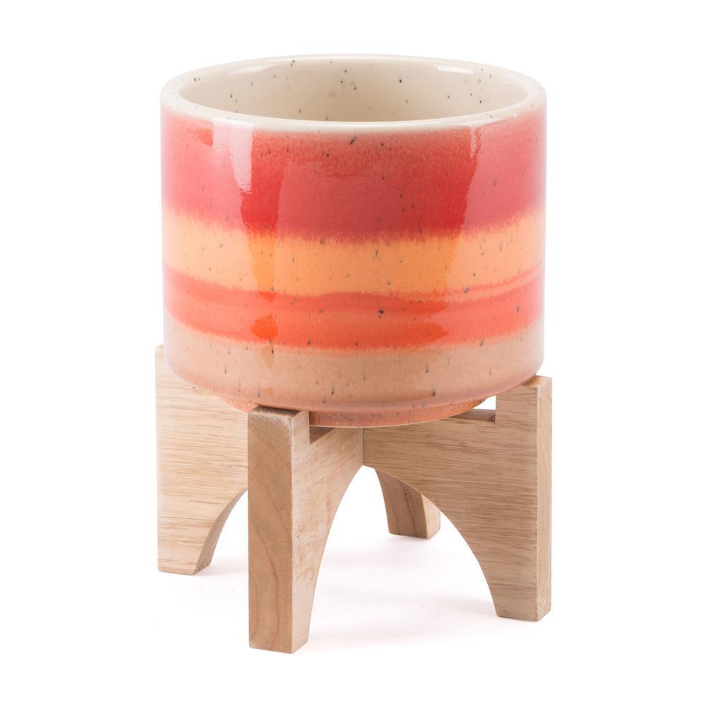 5.5 in. W x 7.1 in. H Orange Ceramic Planter