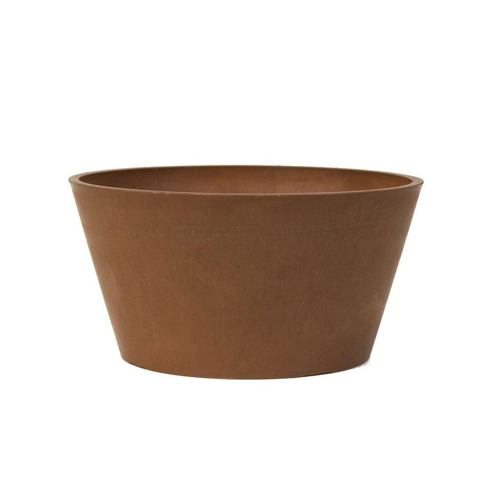 Arcadia Garden Products Sleek 10 in. x 5 in. Chocolate (Brown) PSW Bulb Pan Pot Designed for plants with shallow roots and those grown from bulbs like daffodils, tulips and more. A gently curved rim modernizes the classic silhouette. The PSW Pot Collection is named for its signature material blended from Plastic, Stone and Wood. Color: Chocolate.