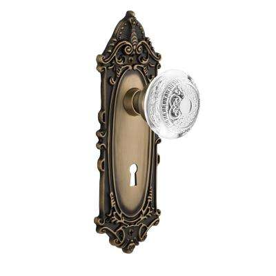 Victorian Plate 2-3/8 in. Backset Antique Brass Privacy Bed/Bath with Keyhole Crystal Egg and Dart Door Knob
