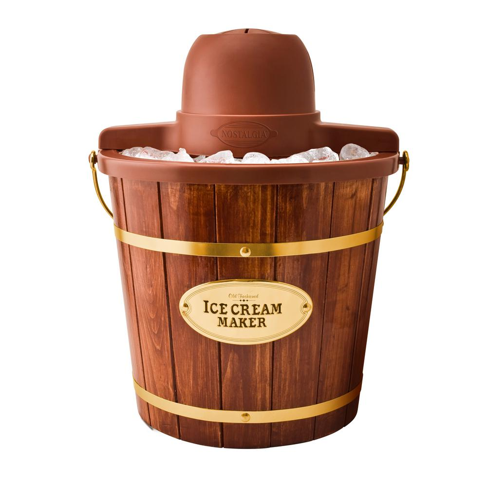 Nostalgia 4 Qt. Wood Bucket Electric Ice Cream Maker, Brown Reminiscent of the old fashion ice cream makers of the past, this unit is a fast and easy way to make 4 Qt. of ice cream, frozen yogurt or gelato. It features a locking motor mount, easy-to-clean bucket and a 4 Qt. aluminum canister. Simply add your ingredients into the aluminum canister, place in the middle of the bucket, layer with ice and salt and allow the electric motor do the rest. The durable churn paddle produces delicious creamy homemade ice cream, while the easy-clean plastic liner provides easy cleanup. Customize each recipe by adding extras like strawberry preserves, cookie dough, candy pieces and much more. When done, use the included lid and lid cap to store leftover ice cream in the freezer. Color: Brown.