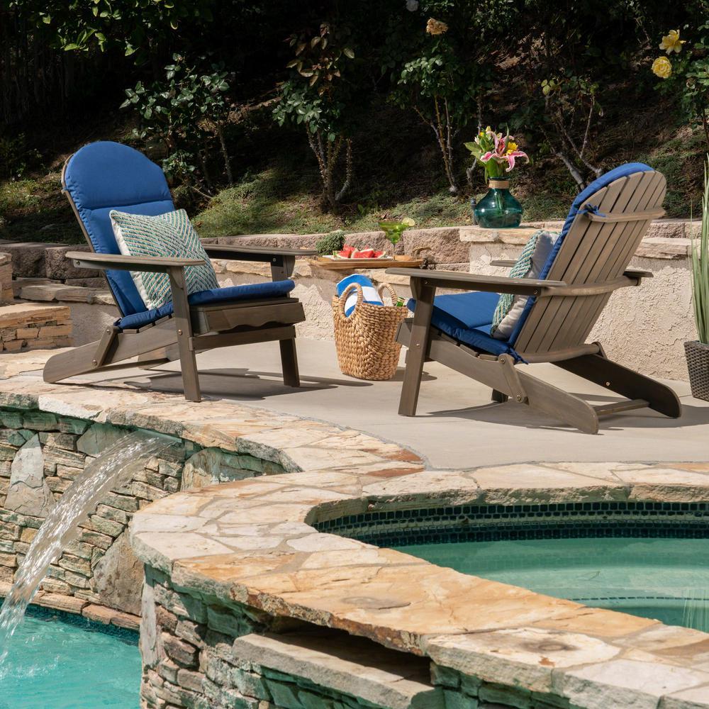 Noble House Malibu Gray Folding Wood Adirondack Chairs with Navy Blue Cushions (2-Pack)
