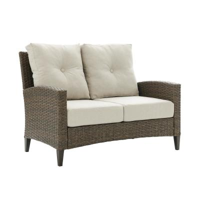Rockport Wicker Outdoor Loveseat with Oatmeal Cushions