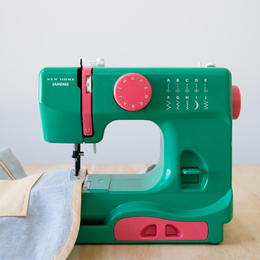 10-Stitch Sewing Machine, Green This compact Janome sewing machine is a great choice for both the experienced sewist and the young enthusiast. This compact machine includes essential features for finishing many types of sewing projects, from simple tasks and mending to scrapbooking and paper crafting. At just 5 lbs., it's perfectly portable. It has ten stitch options and a left and center needle position. It features a tension control dial and a four-point feed dog system. Other colors available. Color: Green.