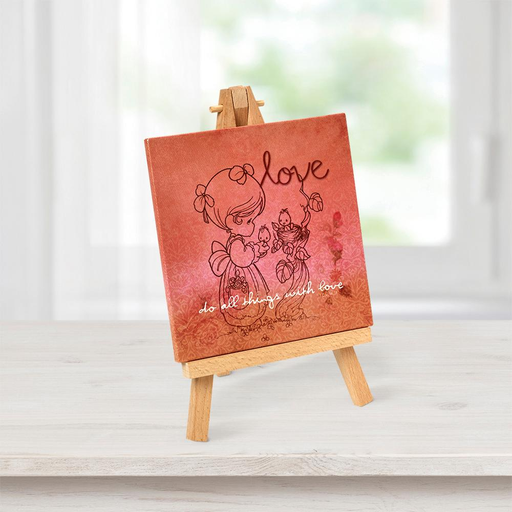 Precious Moments Tabletop Multi-Color Canvas Home Decor Love Picture with Easel Echoing an uplifting sentiment from 1 Corinthians, to do all things with love, this canvas is designed with hues of peach and pink to brighten the soul; included easel allows for easy display anywhere. A truly memorable gift, it brings the spirit of a favorite scripture into any living or workspace with beautiful patterns and traditional Precious Moments illustrations. Give as a religious gift, housewarming gift, inspirational gift or motivational gift for holidays, birthdays or 'just because'. Printed on canvas with wooden easel display. Canvas approximately 8 in. H x 5 in. W. Color: Multi.