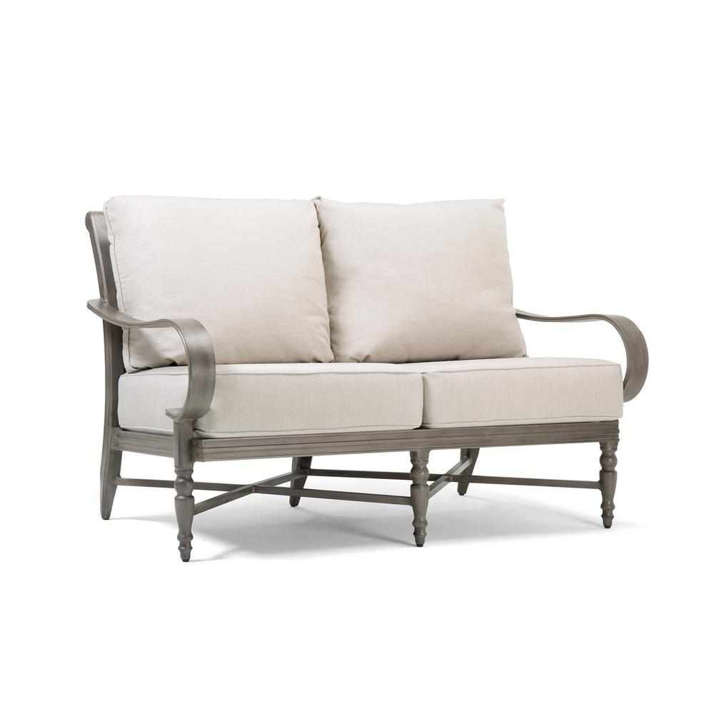 Saylor Wicker Outdoor Loveseat with Outdura Remy Sand Cushion