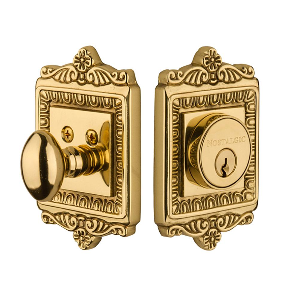 Kwikset Tylo Polished Brass Exterior Entry Door Knob And