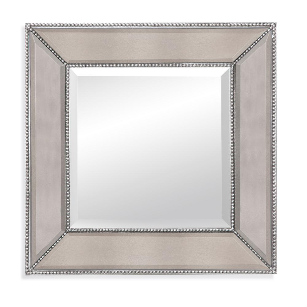 BASSETT MIRROR COMPANY Beaded Decorative Decorative Wall Mirror Silver leaf beading gives our alluring beaded square wall mirror the feel of a family heirloom. Simple but yet sophisticated. The square design can be used as a multiple to create a beautiful focal point within a room.