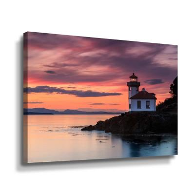 'Orange sunset at Lime Kiln lighthouse' by  Shawn & Corinne severn Canvas Wall Art
