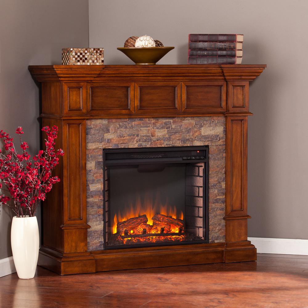 Explore the old west with this handsomely carved Amesbury Faux Stone Corner Electric Fireplace in Buckeye Oak. Glass remains cool to the touch.