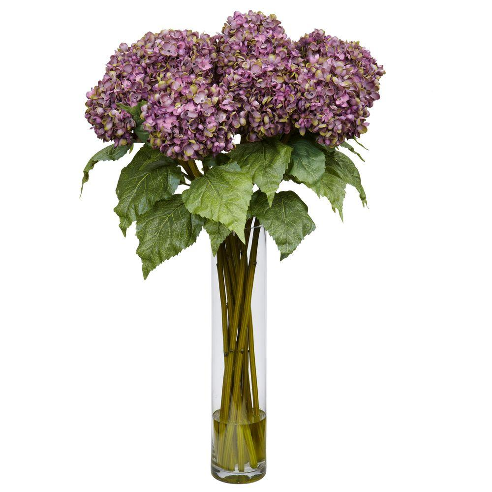 "Nearly Natural 31 in. H Purple Hydrangea Silk Flower Arrangement Bold and beautiful, Hydrangeas are nature's way of saying ""aren't I simply grand"". And you can bring that pronouncement of natural beauty anywhere with this stunning Hydrangea silk flower arrangement. The bold Hydrangea blooms beckon the eye, while the lush leaves provide the perfect underlayment. Complete with an 18 in. vase, this arrangement will become the focal point of any area it adorns."