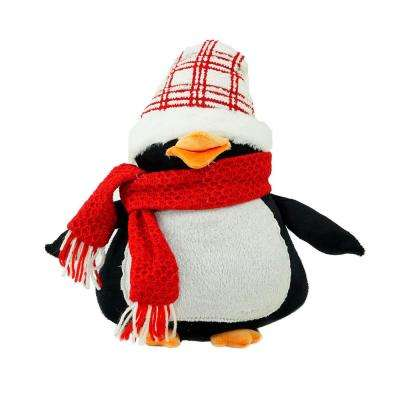 penguin wearing a scarf and plaid hat christmas tabletop decoration