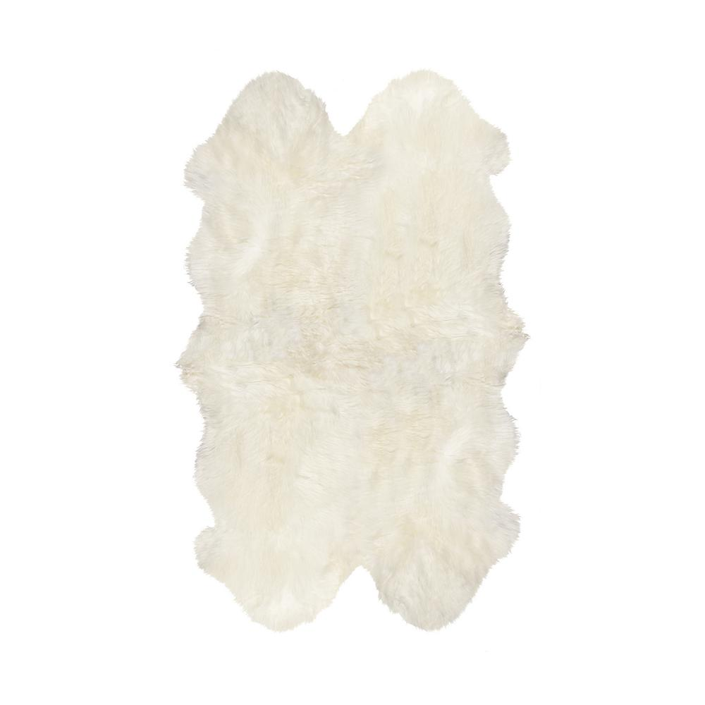 natural New Zealand Natural 3 ft. 9 in. x 6 ft. Four Sheepskin Area Rug