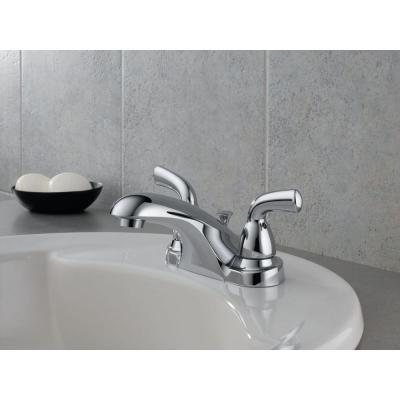 Foundations 4 in. Centerset 2-Handle Low-Arc Bathroom Faucet with Metal Drain Assembly in Chrome