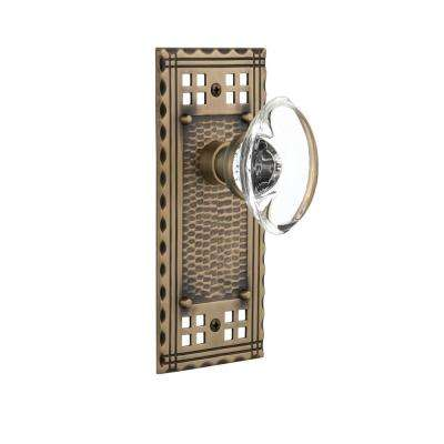 Craftsman Plate 2-3/4 in. Backset Antique Brass Passage Oval Clear Crystal Glass Door Knob