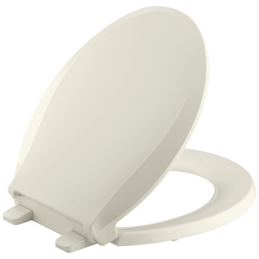 Cachet Quiet-Close Round Front Closed-Front Toilet Seat with Grip-Tight Bumpers