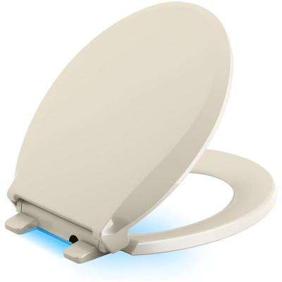 Cachet LED Nightlight Round Quiet Closed Front Toilet Seat in Almond