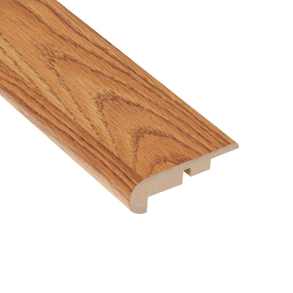TrafficMASTER Draya Oak 11.13 mm Thick x 2-1/4 in. Wide x 94 in. Length Laminate Stair Nose Molding-DISCONTINUED