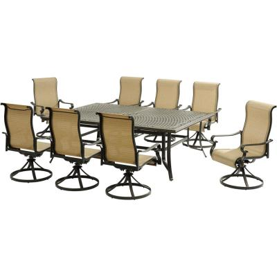 Brigantine 9-Piece Aluminum Outdoor Dining Set with an XL Cast-Top Table and 8-Slingback Swivel Rockers