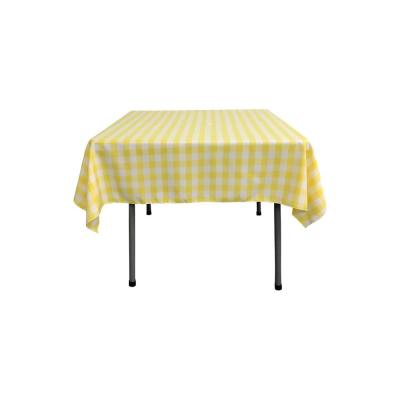 52 in. x 52 in. White and Light Yellow Polyester Gingham Checkered Square Tablecloth