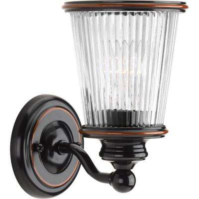 Radiance Collection 1-Light Rubbed Bronze Bath Sconce with Clear Ribbed Glass Shade